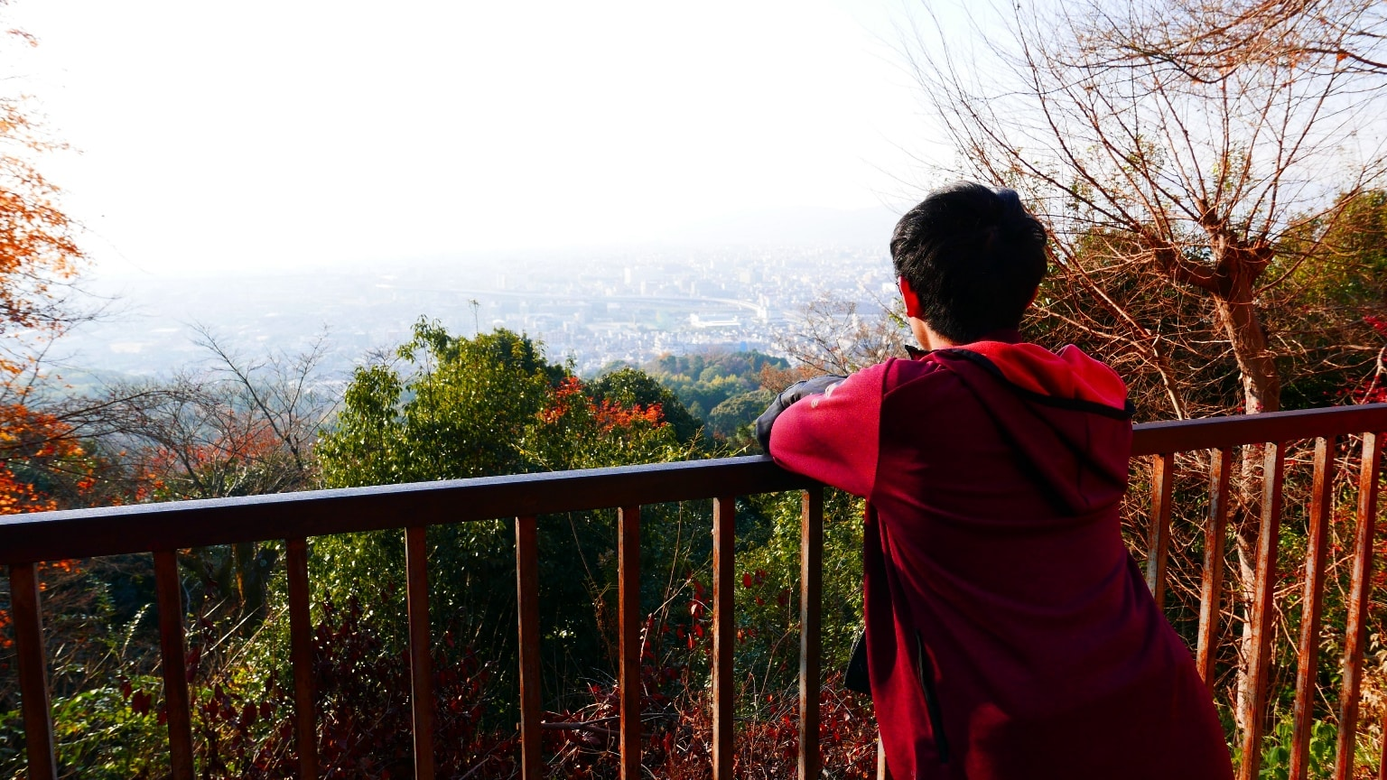 Pausing midway to enjoy the panoramic view of Kyoto