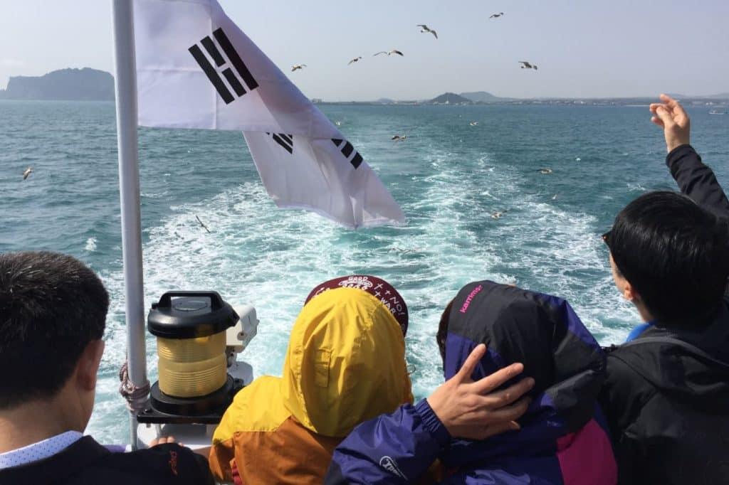 Feeding seagulls on ferry to Udo Island