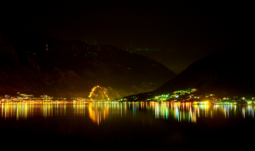 The lighted city walls arcing around Kotor