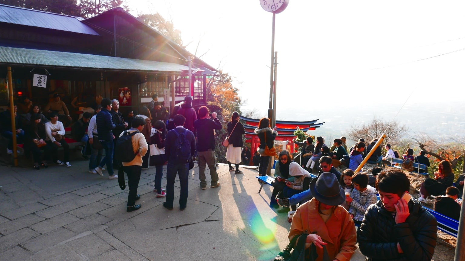 Trekkers at the summit of Mt Inari enjoying a snack and waiting for sunset